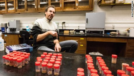 Tor Tornqvist studies climate change, here with soil samples used to assess how quickly neighborhoods are sinking.