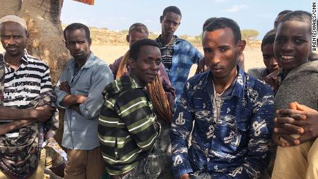 A group of men waiting for smugglers to come to overthrow Bab al-Mandeb Strait to Yemen.