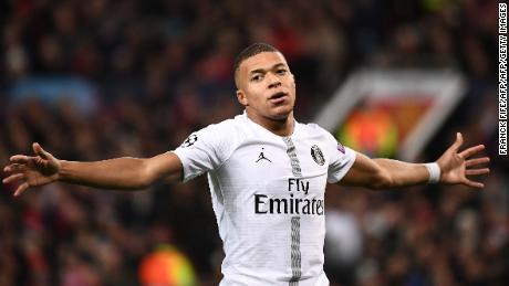 Kylian Mbappe celebrates scoring PSG's second goal.