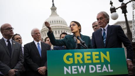 Representative Alexandria Ocasio-Cortez, a Democrat from New York, speaks as Senator Ed Markey, a Democrat from Massachusetts, right, listens during a news conference announcing Green New Deal legislation in Washington, D.C., U.S., on Thursday, Feb. 7, 2019. A sweeping package of climate-change measures unveiled Thursday by Ocasio-Cortez drew a tepid response from House Speaker Nancy Pelosi who didn't explicitly throw her support behind the measure. Photographer: Al Drago/Bloomberg via Getty Images
