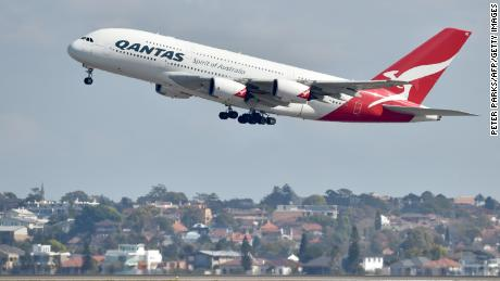 "A Qantas Airbus A380 takes off from the airport in Sydney on August 25, 2017. - Australia's Qantas unveiled plans for the world's longest non-stop commercial flight on August 25, 2017 calling it the ""last frontier of global aviation"", as it posted healthy annual net profits on the back of a strong domestic market. (Photo by PETER PARKS / AFP)        (Photo credit should read PETER PARKS/AFP/Getty Images)"