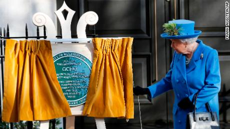 Queen unveils plaque with secret message at UK's codebreaking headquarters