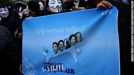 Korean Air pilots, cabin crew and activists, many wearing Guy Fawkes masks, attend a rally on May 4, 2018 in Seoul, South Korea.