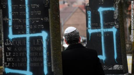Protesters rally against anti-Semitism in France after more graves vandalized