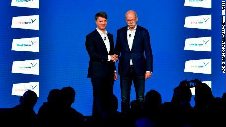 BMW CEO Harald Krueger shakes hands last week with Daimler CEO Dieter Zetsche.