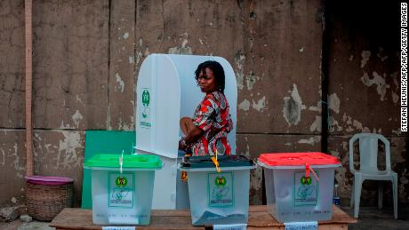 A woman looks over in the ballot boxes one last time before casting her vote on Saturday.