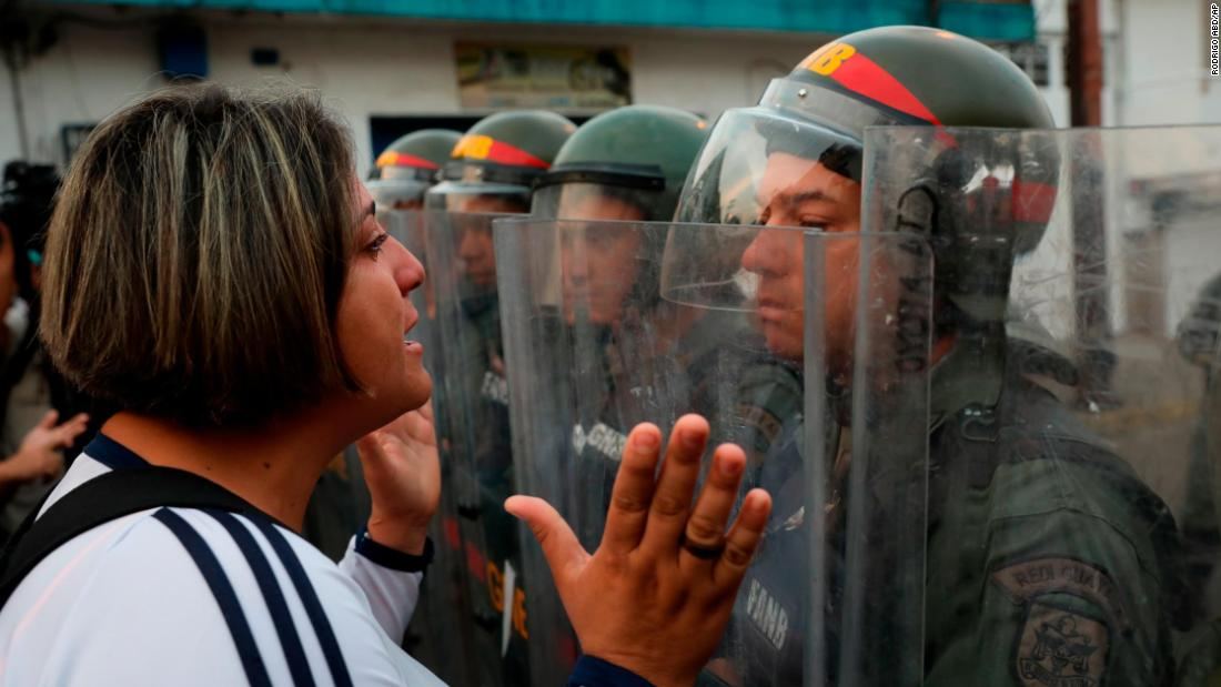 A demonstrator confronts a member of the Venezuelan National Guard on Saturday, February 23, in Urena, Venezuela, near the Colombian border.