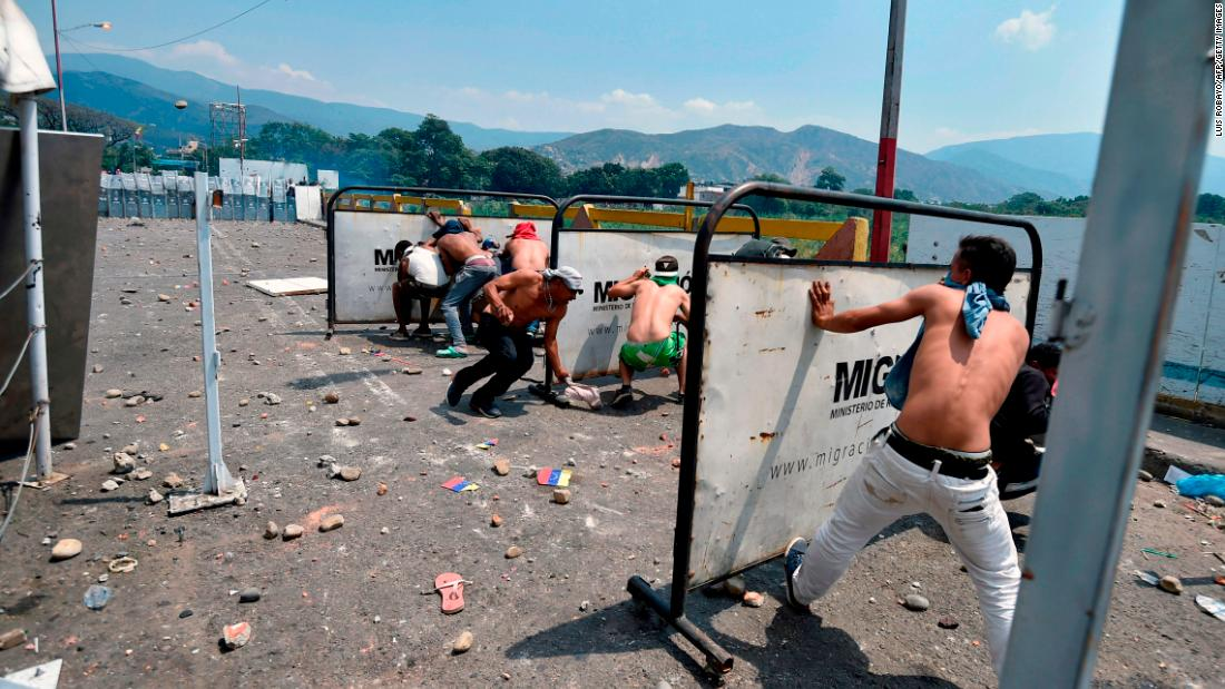 Demonstrators clash with Venezuelan soldiers at the Simon Bolivar International Bridge in Cucuta, Colombia, on February 23.