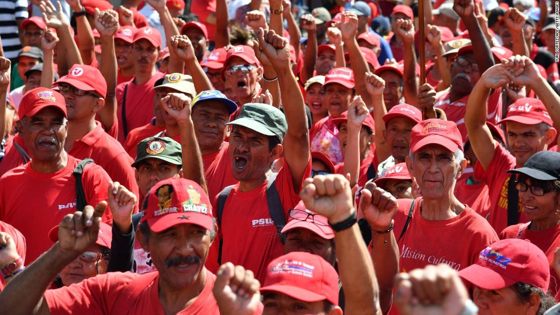 Supporters of Venezuelan President Nicolas Maduro take part in a march in Caracas on February 23.