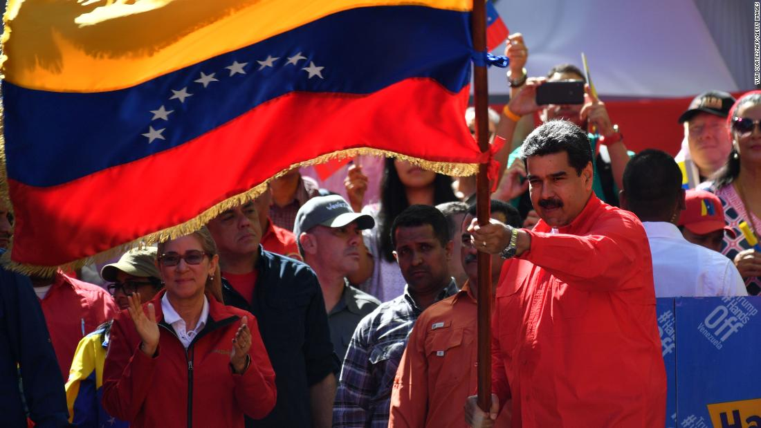Venezuelan President Nicolas Maduro waves the national flag during a pro-government march in Caracas on February 23. During the rally at the Venezuelan capital, Maduro told supporters he is breaking all diplomatic relations with Colombia and is calling for its ambassadors and consuls to leave Venezuela.
