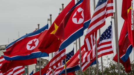 HANOI, VIETNAM - FEBRUARY 24: North Korean, U.S.A and Vietnamese flags are flown on February 24, 2019 in Hanoi, Vietnam. Preparations continue in Hanoi before the second summit between North Korea's leader Kim Jong-un and U.S President Donald Trump. Mr Kim is due to arrive in Vietnam by train one day before the meeting for an official visit at the invitation of Vietnam's President Nguyen Phu Trong and is widely expected to discuss Vietnam's reforms, which have seen it become of one of the fast-growing economies in the world and have been suggested as a road map for the impoverished hermit kingdom. (Photo by Carl Court/Getty Images)