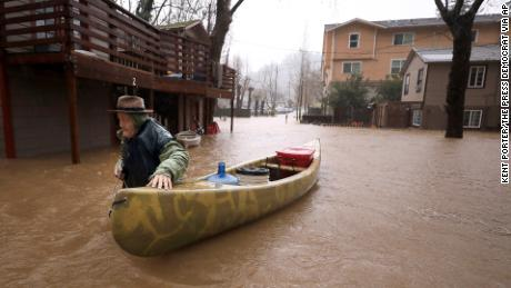 Jesse Hagan evacuates to higher ground Tuesday in Guerneville
