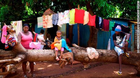 A Chagosian family in the slum of Baie du Tombeau, in Mauritius, with a Chagossian flag.