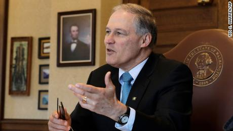 Washington Gov. Jay Inslee speaks during a morning meeting with staff members in his office, Wednesday, February 27, 2019, at the Capitol in Olympia, Washington.