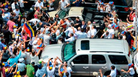 Juan Guaido is greeted by supporters upon his arrival in Caracas on Monday.