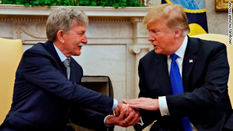 President Donald Trump, right, shakes hands with Danny Burch, a former U.S. hostage held in Yemen, Wednesday, March 6, 2019, in the Oval Office of the White House in Washington. (AP Photo/Jacquelyn Martin)