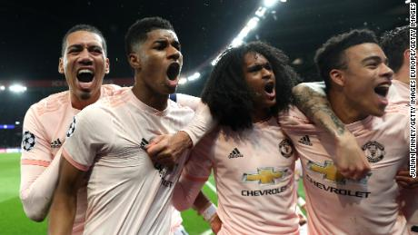 Manchester United players celebrate after their last 16 victory over PSG.