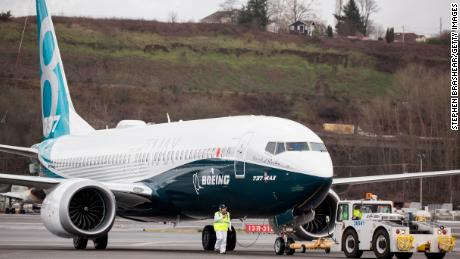 SEATTLE, WA - JANUARY 29: A Boeing 737 MAX 8 airliners taxis after landing at Boeing Field to complete its first flight on January 29, 2016 in Seattle, Washington. The 737 MAX is the newest generation of Boeing's most popular airliner featuring more fuel efficient engines and redesigned wings. (Photo by Stephen Brashear/Getty Images)