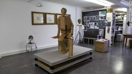 A cardboard version of the statue stands in the studio.