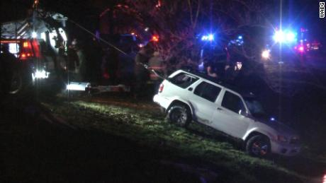 The SUV is removed from the creek Saturday.
