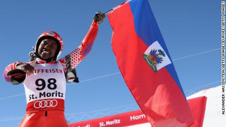 Marti waves her national flag at the finish area in St Moritz.