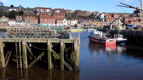 Whitby is a seaside town in northern England that's bisected by a long, narrow harbor.