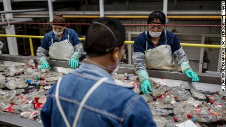 Workers sort plastic waste at a plastic recycling plant in Mexico.
