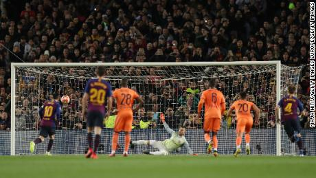 Messi scored from the penalty spot to give his side the lead against Lyon.