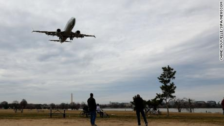 (190313) -- WASHINGTON, March 13, 2019 (Xinhua) -- An American Airlines Boeing 737 Max 8 aircraft from Los Angeles approaches to land at Washington Reagan National Airport in Washington D.C., the United States on March 13, 2019. The United States is grounding all Boeing 737 Max 8 and 9 aircraft, said U.S. President Donald Trump Wednesday, as the country becomes the last major country to do so after two crashes by the model in recent months. (Xinhua/Ting Shen)