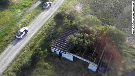 This image released by Mexico's Navy shows the site where 72 Central and South American migrants were found slain in 2010, less than 100 miles from the U.S. border.