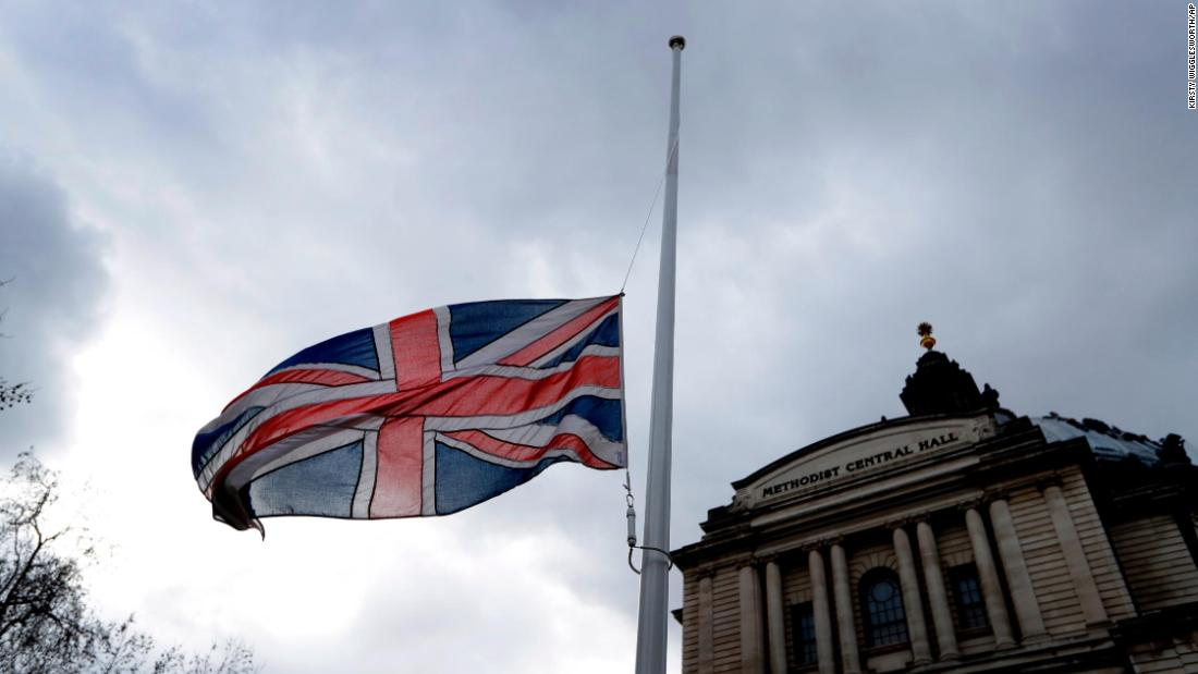 A flag flies at half-staff in London on March 15.