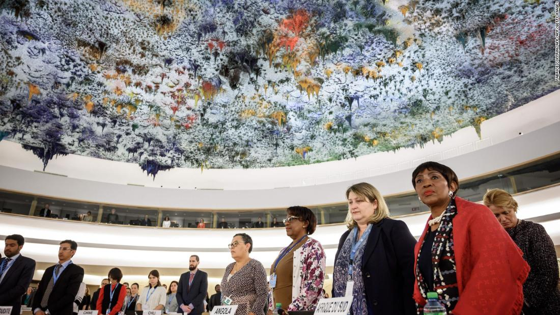 Delegates stand during a minute of silence that was observed at the United Nations Human Rights Council in Geneva, Switzerland.