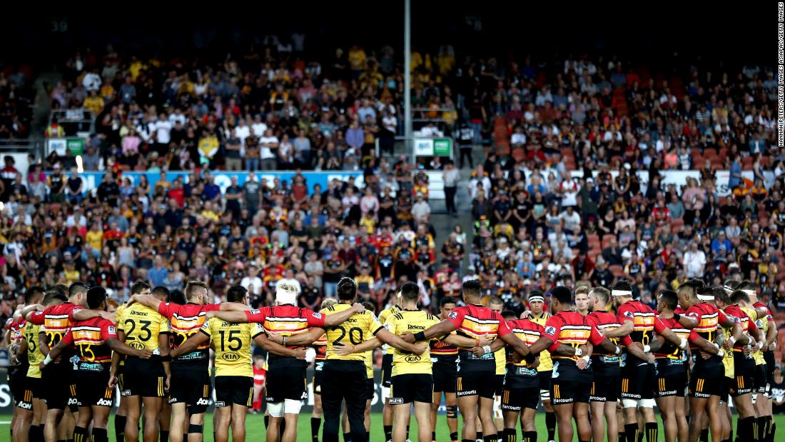 The Chiefs and Hurricanes gather together to remember the victims ahead of a professional rugby match in Hamilton, New Zealand.
