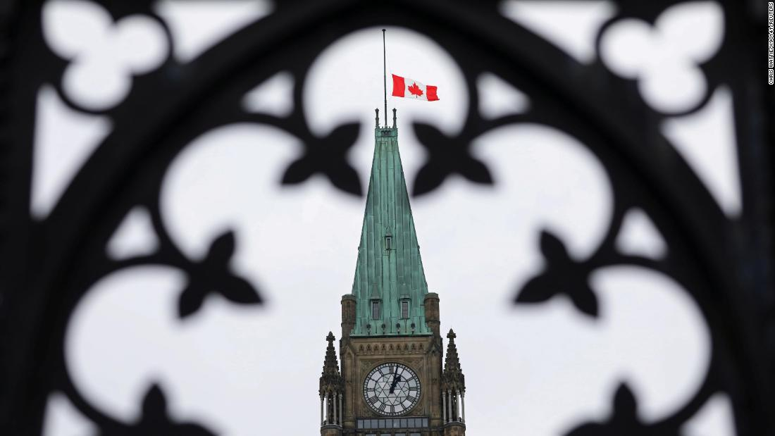The Canadian flag flies at half-staff on the Peace Tower in Ottawa.