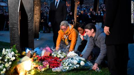 People taking part in a vigil at the New Zealand War Memorial at Hyde Park Corner in London.