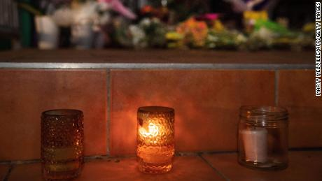 Flowers and candles on the front steps of the Kilbirnie Mosque in Wellington, New Zealand, on Friday.