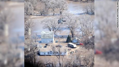 Nebraska National Guard performing an air rescue near Arlington, NE. These teams have saved dozens of people in the last 24 hours.