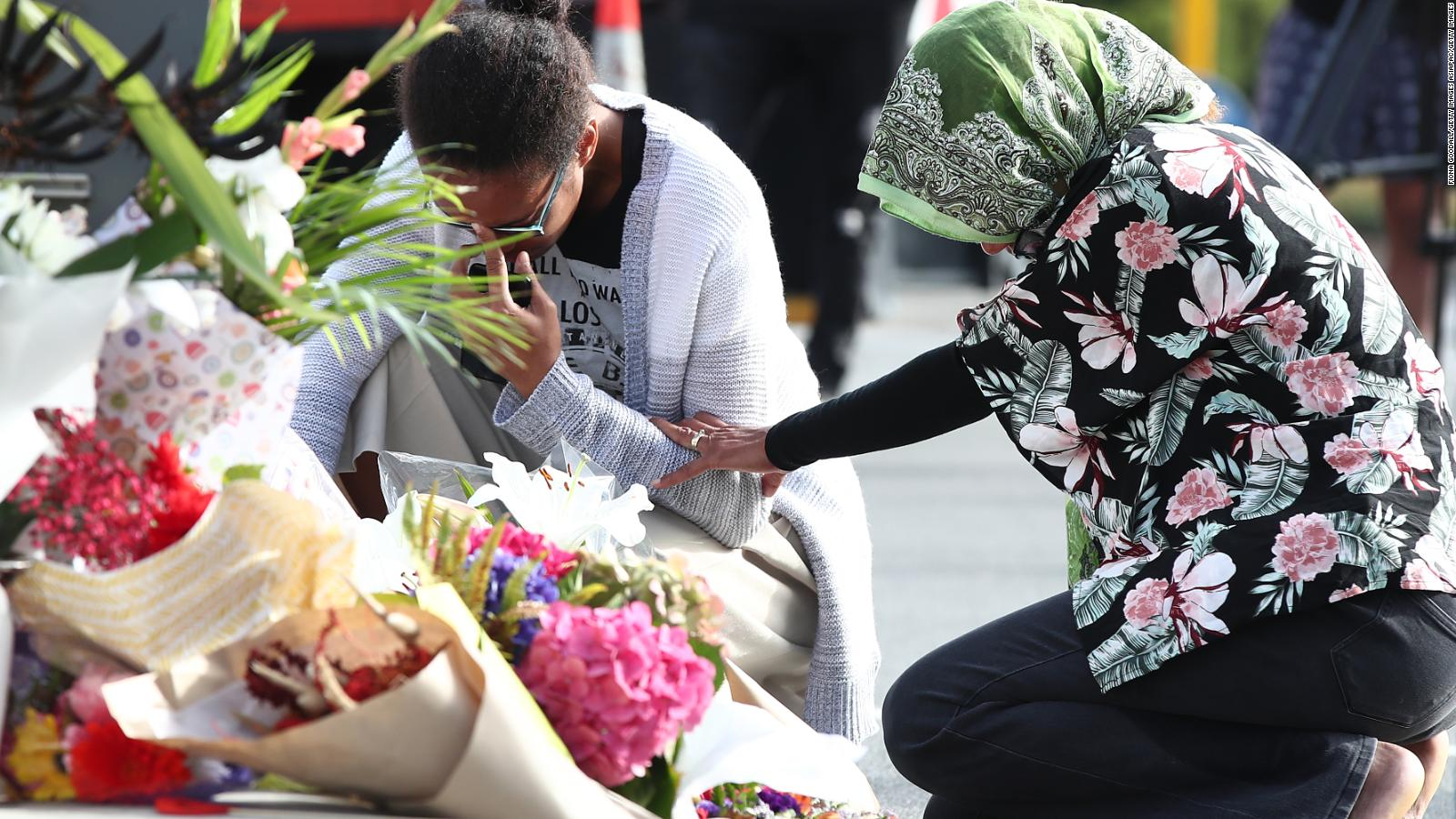 Locals lay flowers in tribute to those killed and injured at Deans Avenue near the Al Noor Mosque in Christchurch, New Zealand.
