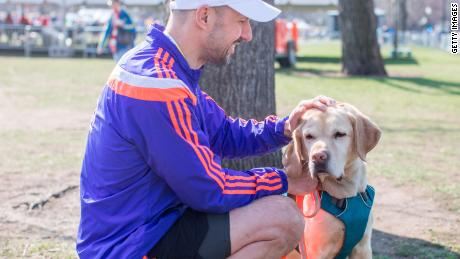 Thomas Panek completes the 2018 BAA 5K in Boston, led by his guide dog Gus.
