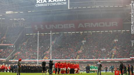 Players observe a minute's silence for the victims of a mass shooting in New Zealand.