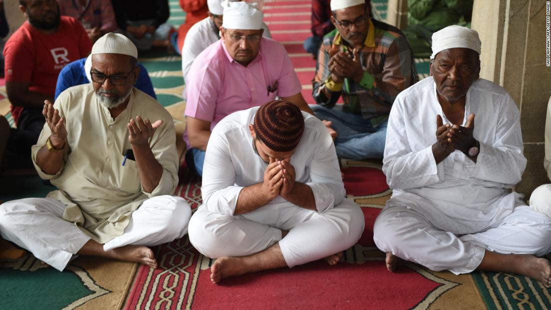 Indian Muslims at Siddi Sayed Jaali in Ahmedabad pray March 16 in solidarity with the Christchurch victims.