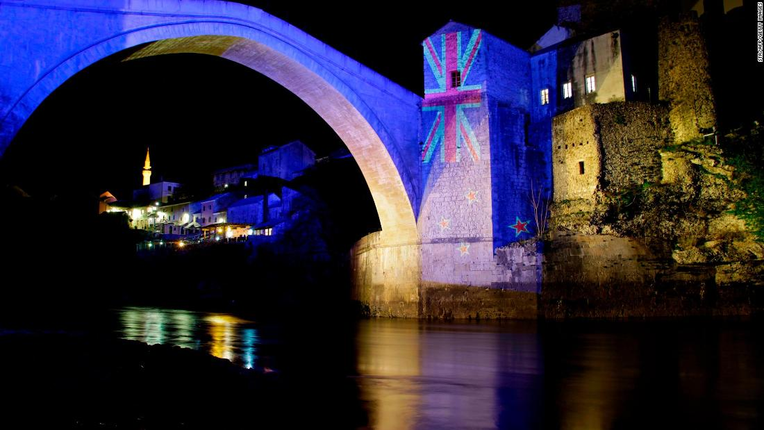 The colors of the New Zealand flag are projected onto the historic Old Bridge over the Neretva River in Mostar, Bosnia-Herzigovina, to commemorate the victims of the deadly mosque attacks in Christchurch.