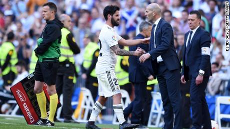 Isco of Real Madrid shakes hands with Zinedine Zidane, back for his second spell in charge.