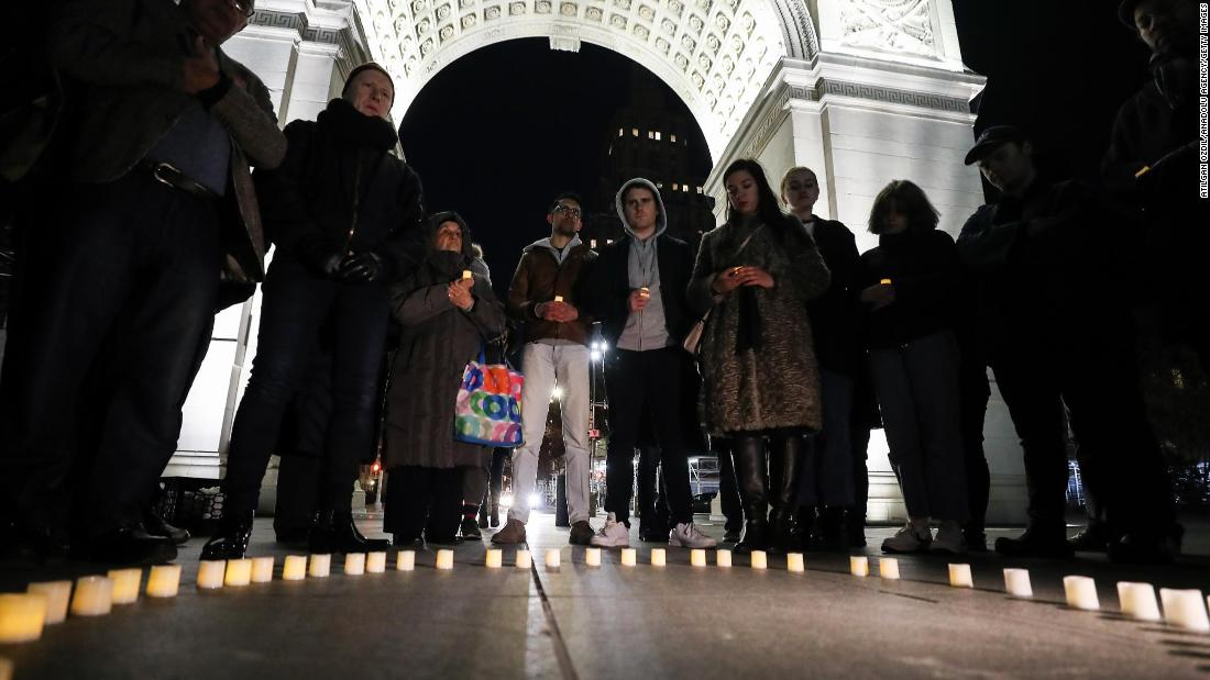 People hold a vigil at Washington Square Park in New York on March 16.