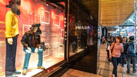 Pedestrians walking past a Prada store in Hong Kong. The company posted disappointing earnings on Friday, sending its stock down as much as 10%.