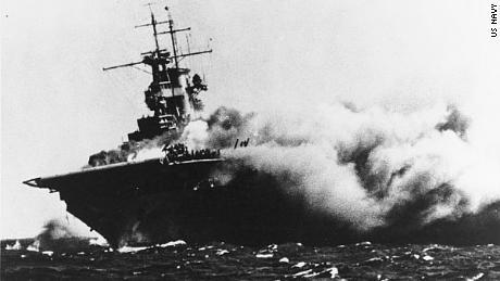 The USS Wasp tilts heavily after a Japanese torpedo strike set the hull ablaze.