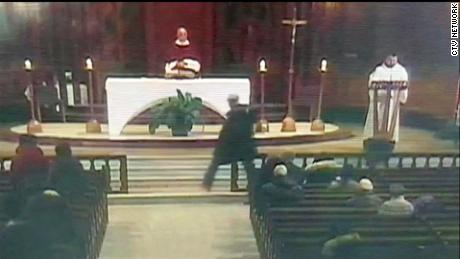 Priest stabbed live on TV at Canada's biggest church