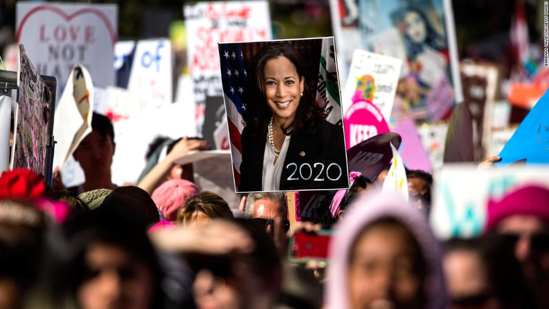 A person holds a Harris poster during the Women's March in Los Angeles in January 2019.