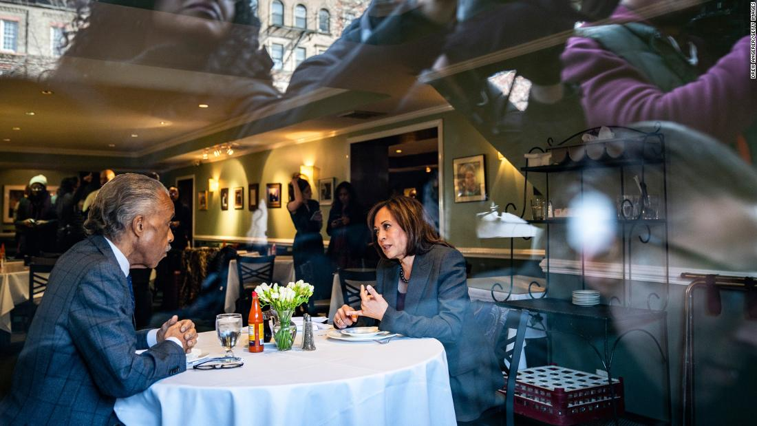 Media members photograph Harris and the Rev. Al Sharpton as they have lunch at Sylvia's Restaurant in New York in February 2019.
