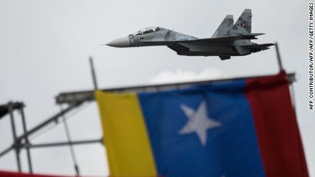 Russian-made Venezuelan Air Force Sukhoi Su-30MKV multirole strike fighters overfly a military parade to celebrate Venezuela's 206th anniversary of its Independence in Caracas on July 5, 2017. 